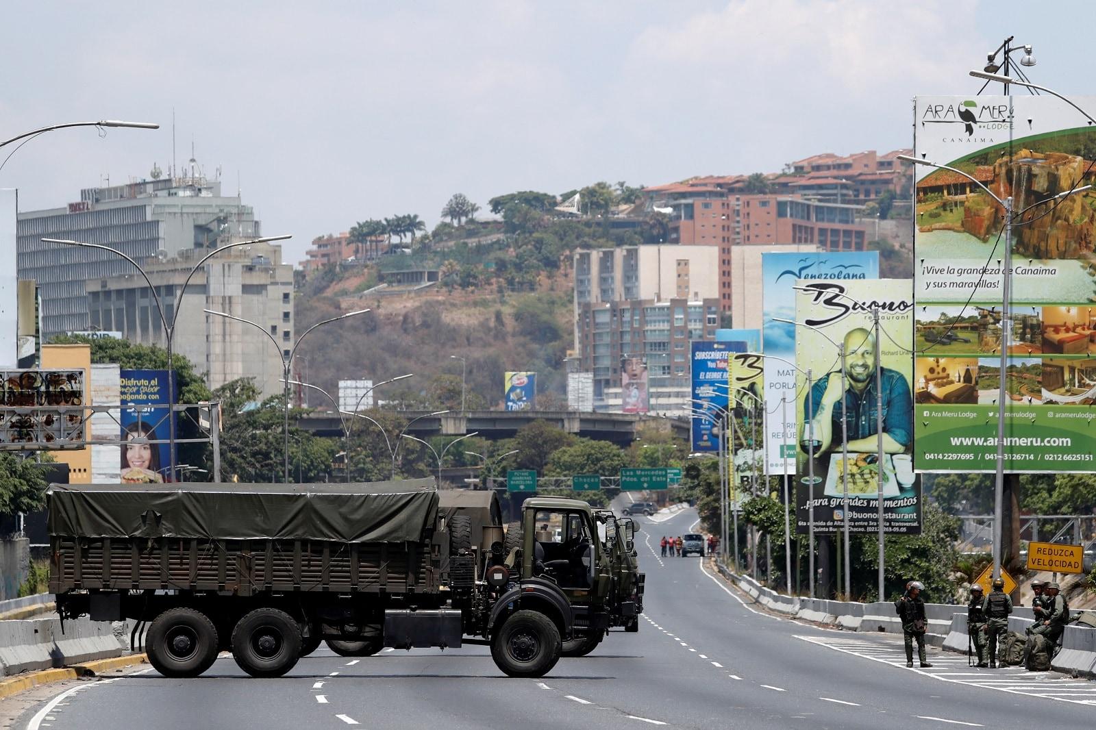 Military trucks partially block a highway in Caracas, Venezuela April 30, 2019. REUTERS/Carlos Garcia Rawlins