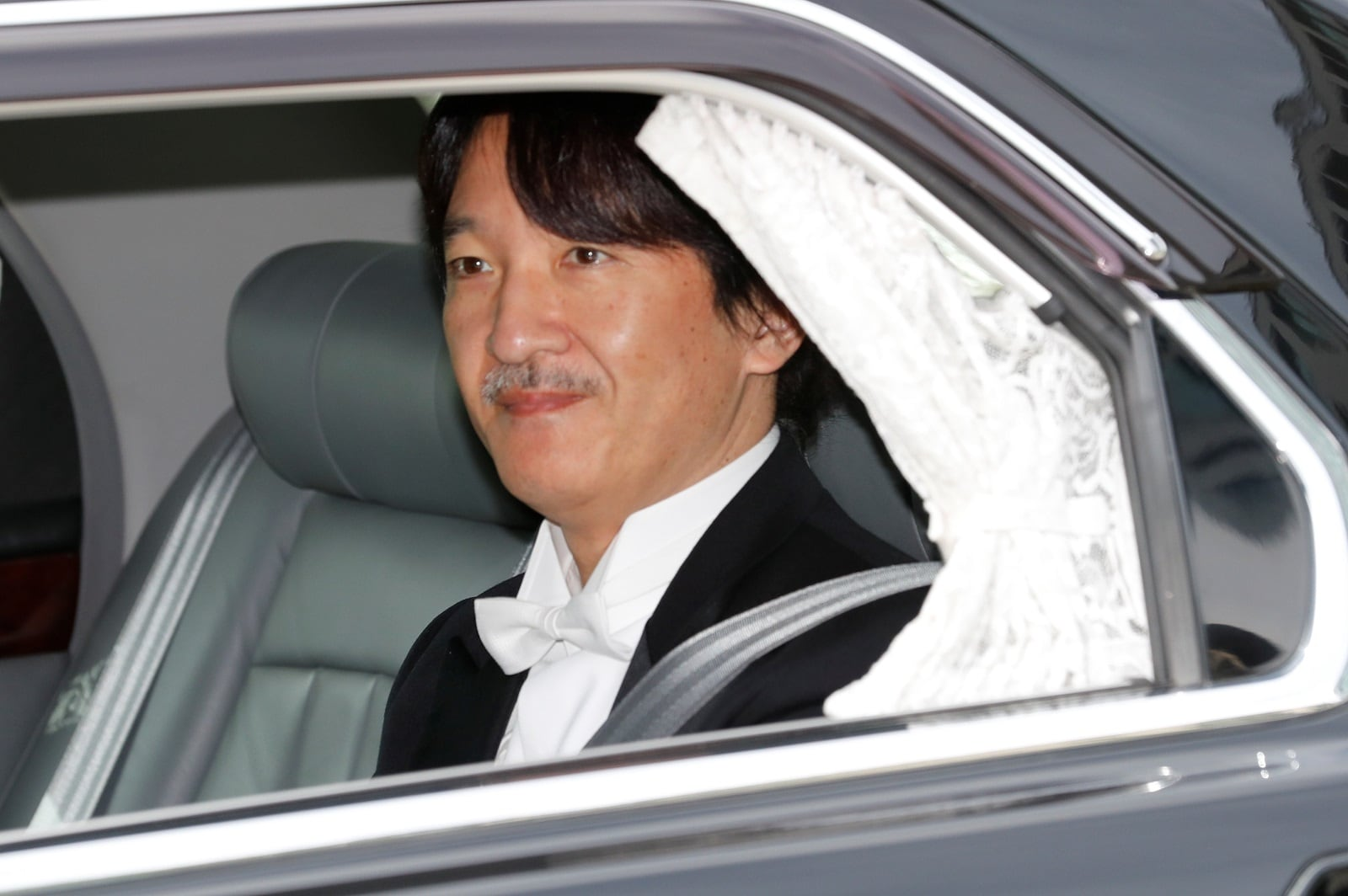 Japan's new Crown Prince Akishino looks from his vehicle upon arriving at the Imperial Palace in Tokyo, Japan May 1, 2019. REUTERS/Kim Kyung-Hoon