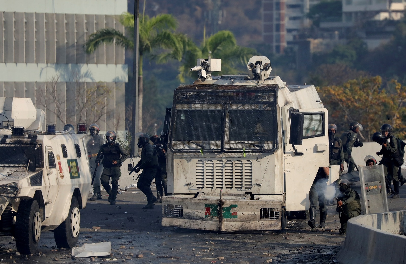 A member of security forces fires his weapon during clashes with demonstrators in Caracas, Venezuela May 1, 2019. REUTERS/Manaure Quintero