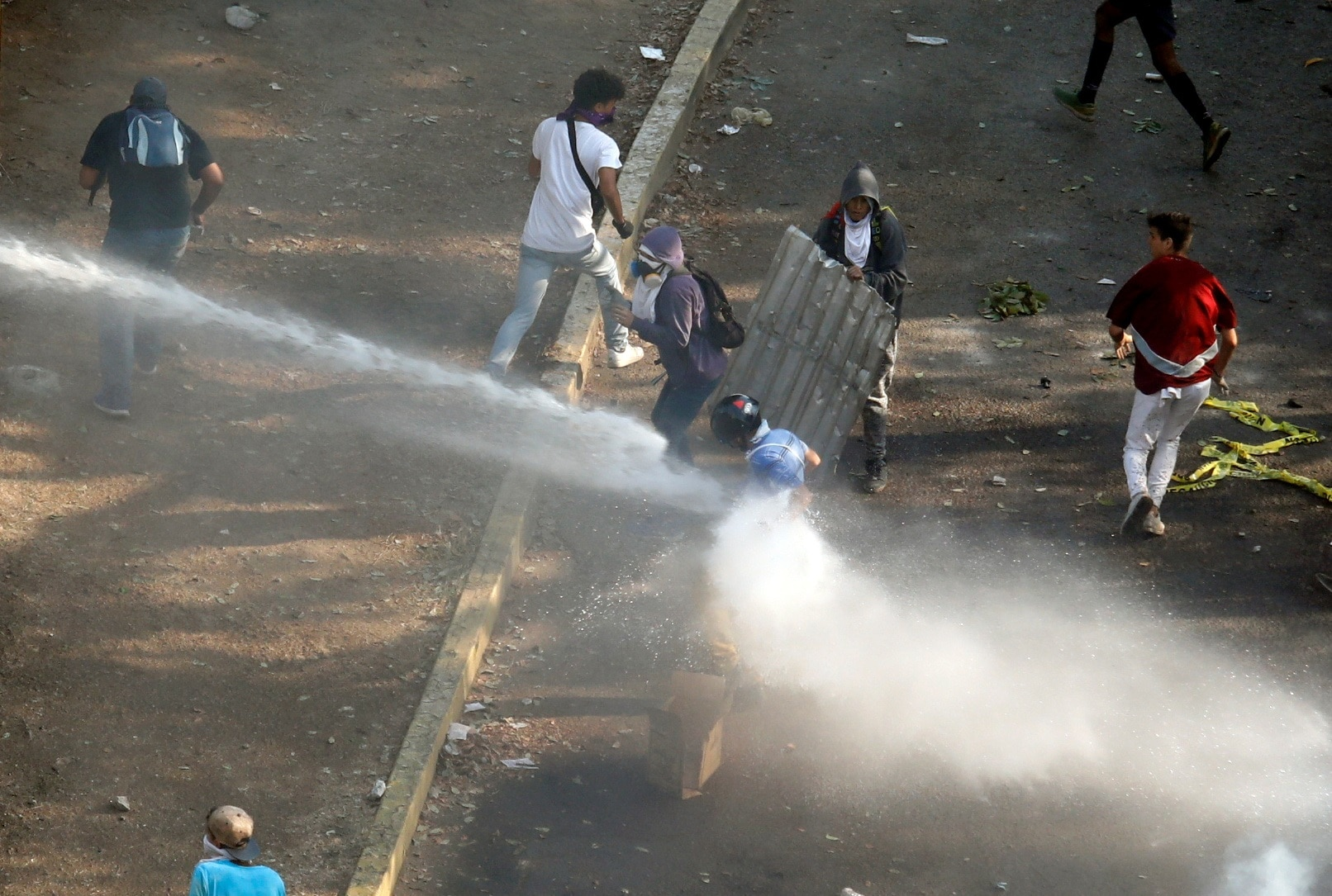 A demonstrator is being sprayed with water during clashes with security forces in Caracas Venezuela, May 1, 2019. REUTERS/Adriana Loureiro