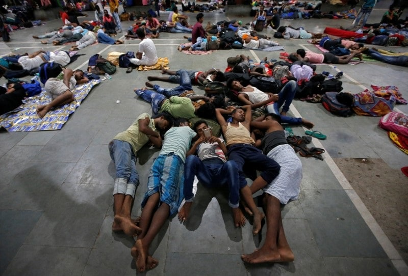 Stranded passengers rest inside a railway station after trains between Kolkata and Odisha were cancelled ahead of Cyclone Fani, in Kolkata, West Bengal, May 3, 2019. REUTERS/Rupak De Chowdhuri