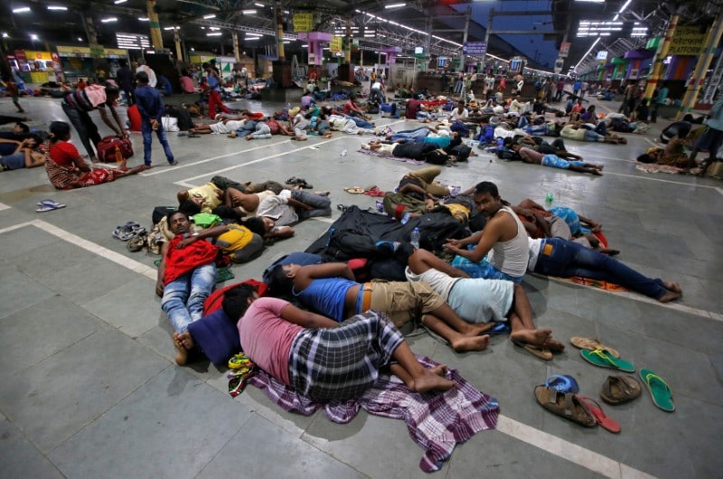 Stranded passengers rest inside a railways station after trains between Kolkata and Odisha were cancelled ahead of Cyclone Fani, in Kolkata, India, May 3, 2019. (Reuters)