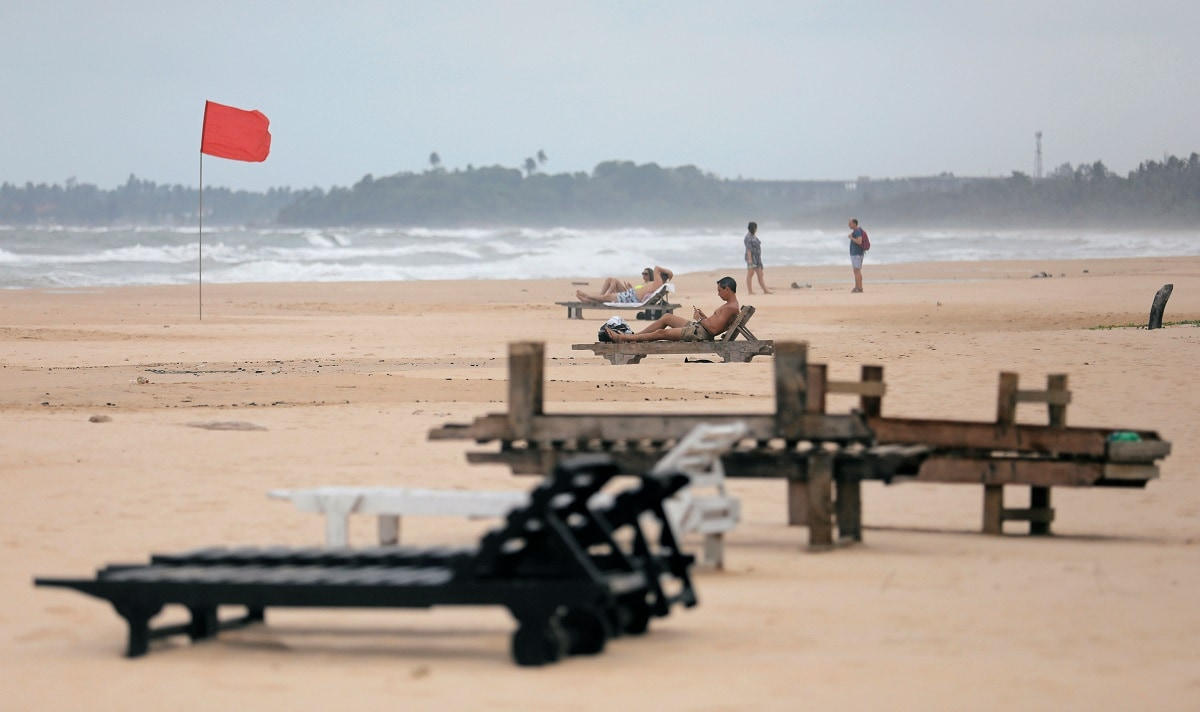 Empty sunbathing chairs are seen on a beach near hotels in a tourist area in Bentota, Sri Lanka. (REUTERS/Dinuka Liyanawatte)