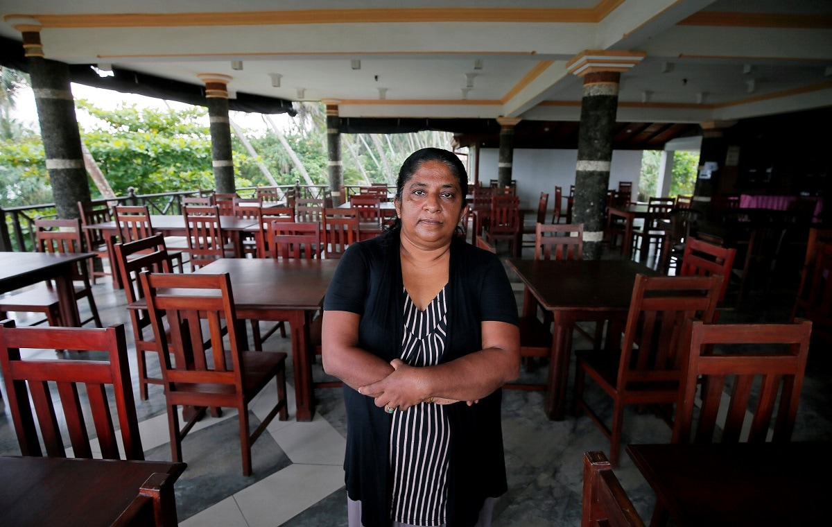 Samanmali Colonne, 51, poses for a photograph inside the Warahena Beach hotel in Bentota. (REUTERS/Dinuka Liyanawatte)