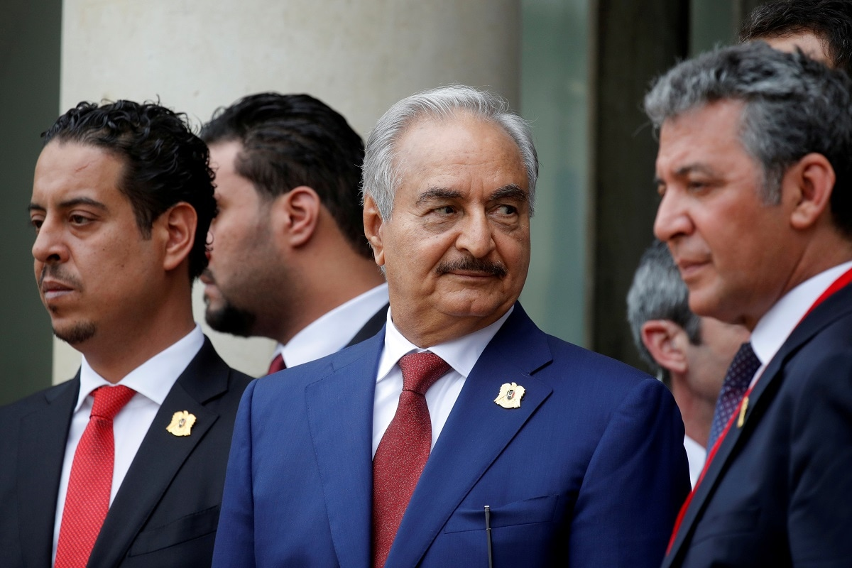 Khalifa Haftar (C), the military commander who dominates eastern Libya, leaves after an international conference on Libya at the Elysee Palace in Paris. REUTERS/Philippe Wojazer/File Photo