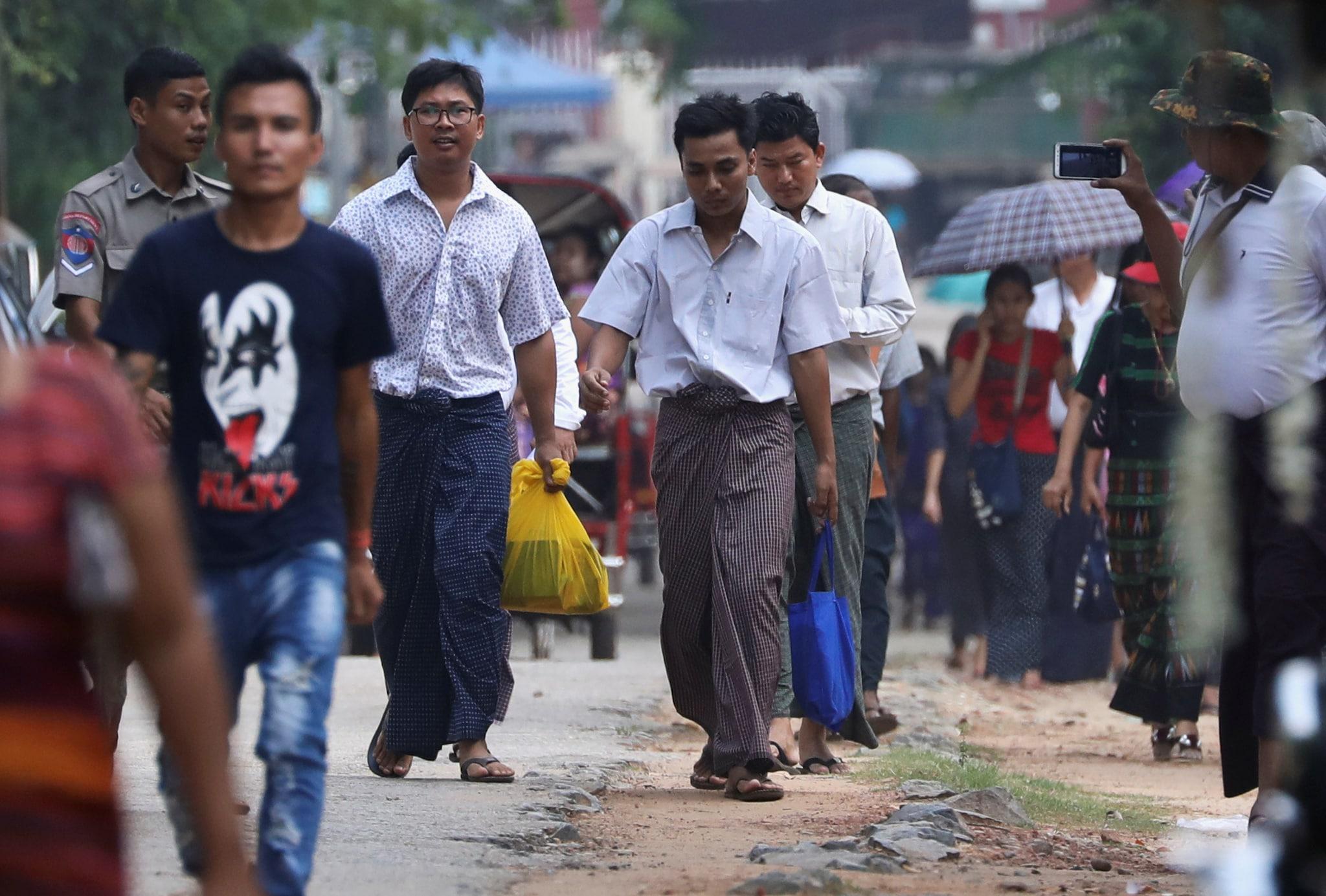 Reuters reporters Wa Lone and Kyaw Soe Oo walk free outside Insein prison after receiving a presidential pardon in Yangon, Myanmar, May 7, 2019. REUTERS/Ann Wang