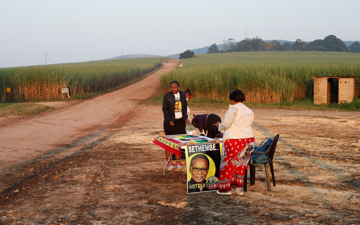 Inkatha Freedom Party agents are seen near a polling station in the Farmlands near Eshowe. (REUTERS/Rogan Ward)