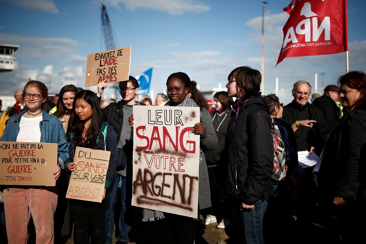 People attend a demonstration to protest against the loading of weapons aboard the Bahri-Yanbu, a cargo ship operating for Saudi Arabia's defence and interior ministries, in Le Havre, France, May 9, 2019. The banner reads: