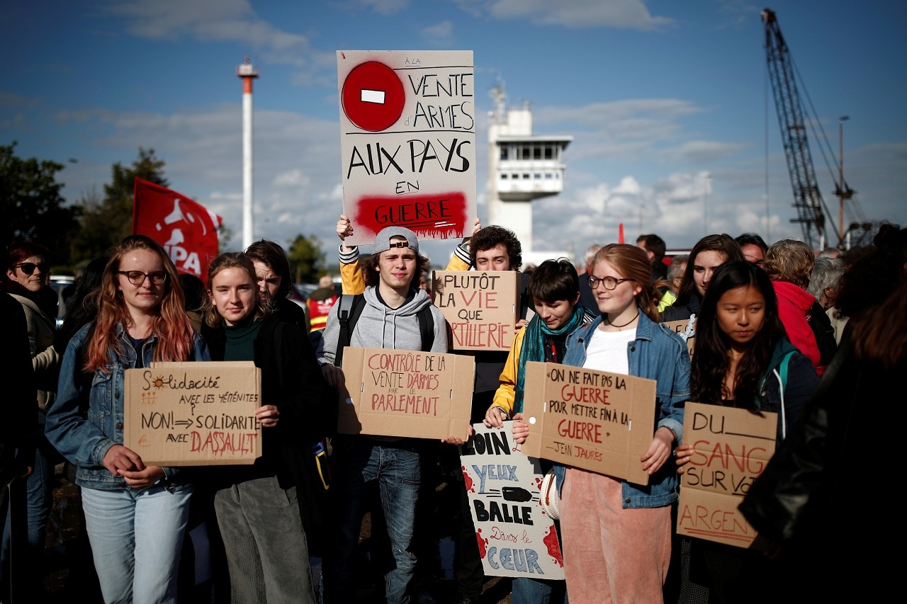 People attend a demonstration to protest against the loading of weapons aboard the Bahri-Yanbu, a cargo ship operating for Saudi Arabia's defence and interior ministries, in Le Havre, France, May 9, 2019. (Reuters)