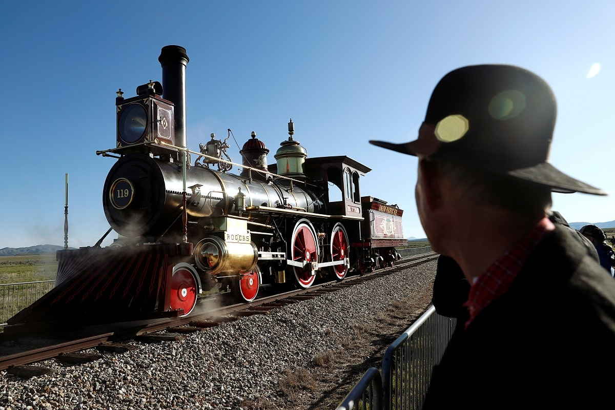 A replica of the historic No. 119 steam locomotive rolls across Promontory Summit on the 150th anniversary of the completion of the Transcontinental Railroad at Golden Spike National Historical Park in Promontory, Utah. REUTERS/Terray Sylvester