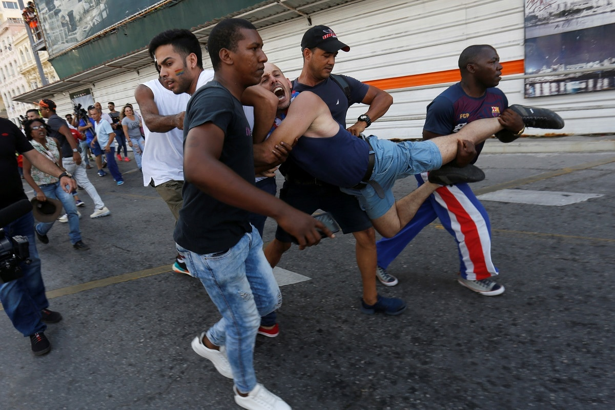 A Cuban LGBT activist is detained by plain-clothed security personnel while participating in an annual demonstration against homophobia and transphobia in Havana. REUTERS/Stringer