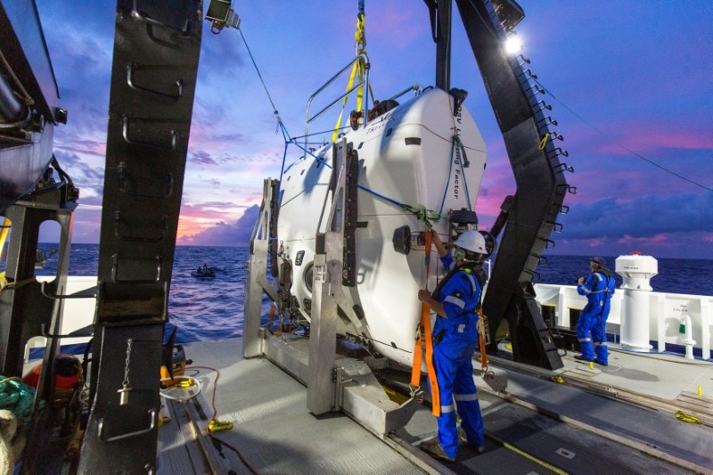 A technician checks the submarine DSV Limiting Factor aboard the research vessel DSSV Pressure Drop above the Pacific Ocean's Mariana Trench in an undated photo released by the Discovery Channel May 13, 2019. Atlantic Productions for Discovery Channel/Tamara Stubbs/Handout via REUTERS.