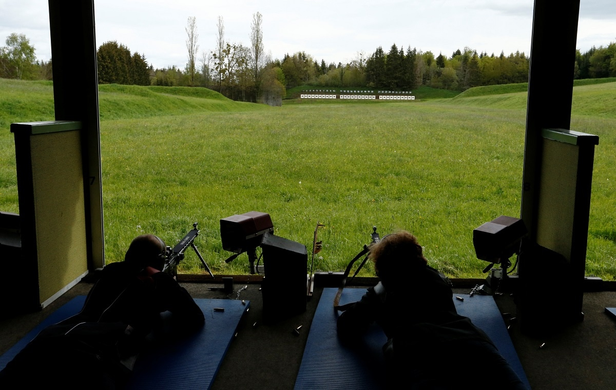 Participants take part in the Fribourg County 300m rifle final. REUTERS/Denis Balibouse