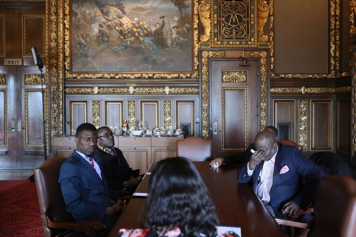 Liberian immigration activists, led by Erasmus Williams, Pastor Francis Tabla and Kamaty Diahn ask staff members why their meeting with Minnesota Governor Tim Walz was cancelled, the day after the DED (Deferred Enforced Departure) status was extended for one year by the Trump administration. REUTERS/Jonathan Ernst