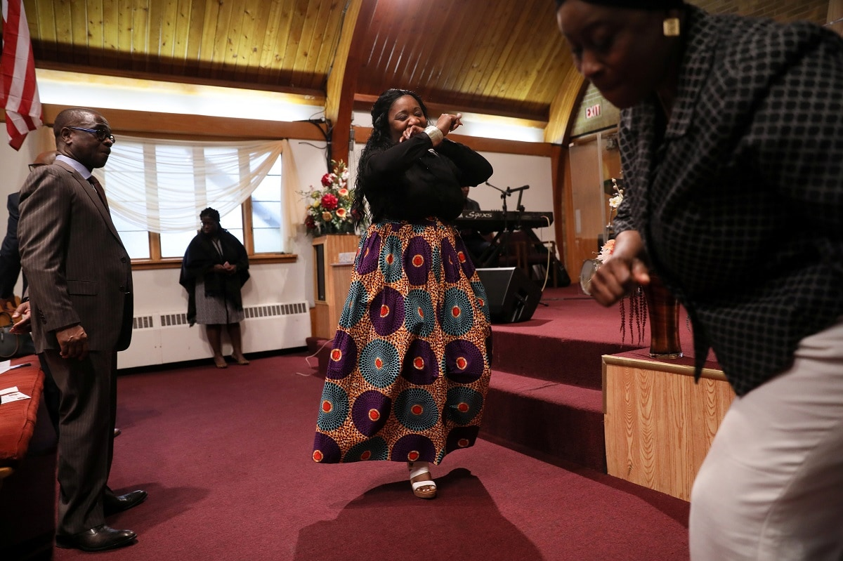 Deferred Enforced Departure (DED) status holders and supporters dance during a thanksgiving service on Sunday after the DED status was extended, meaning they were not in immediate danger of family separation, in Robbinsdale, Minnesota. REUTERS/Jonathan Ernst