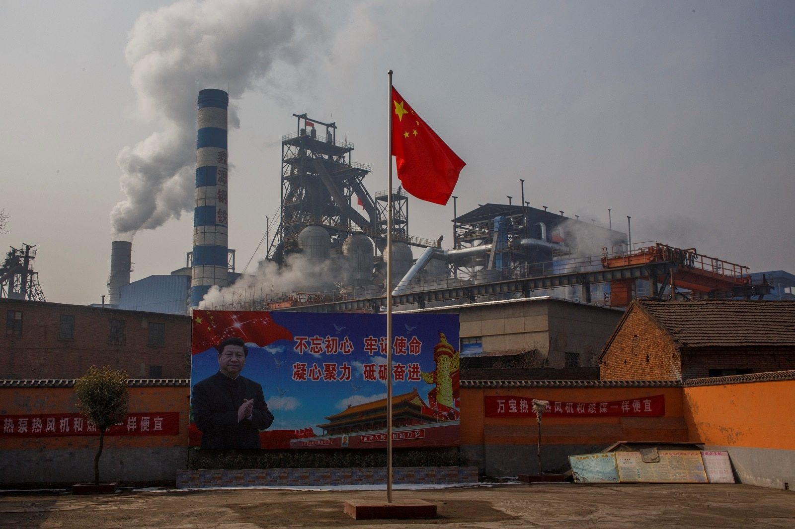 A poster showing Chinese President Xi Jinping is seen in front of the Xinyuan Steel plant in Anyang, Henan province, China February 19, 2019. REUTERS/Thomas Peter