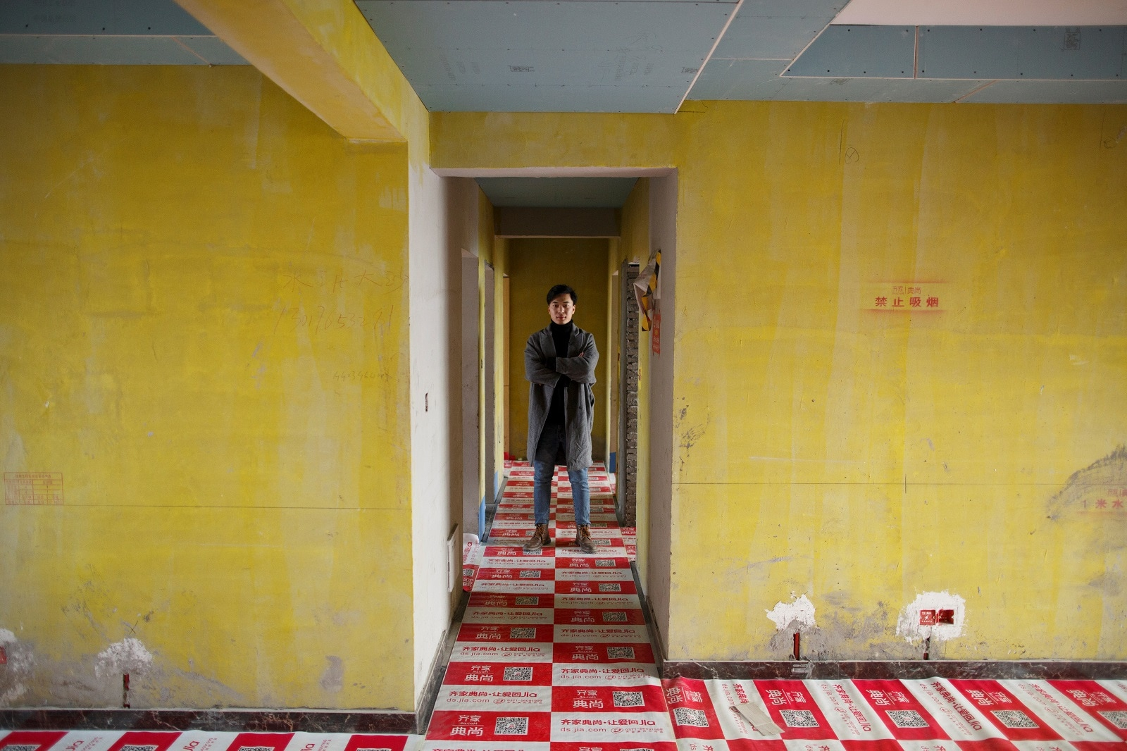 Interior designer Zhang Chenxuan, who has run an interior design business in Zhengzhou for seven years, poses in an apartment his company is fitting out in a high-rise in Zhengzhou, Henan province, China, February 20, 2019. REUTERS/Thomas Peter