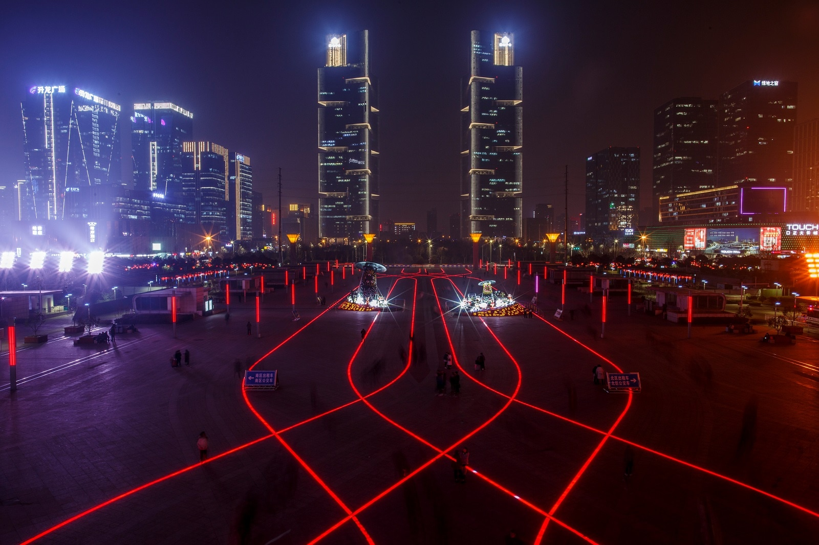 LED lights in the pavement illuminate the square in front of a high-speed railway station in the new business district of Zhengzhou, Henan province China, February 22, 2019. REUTERS/Thomas Peter