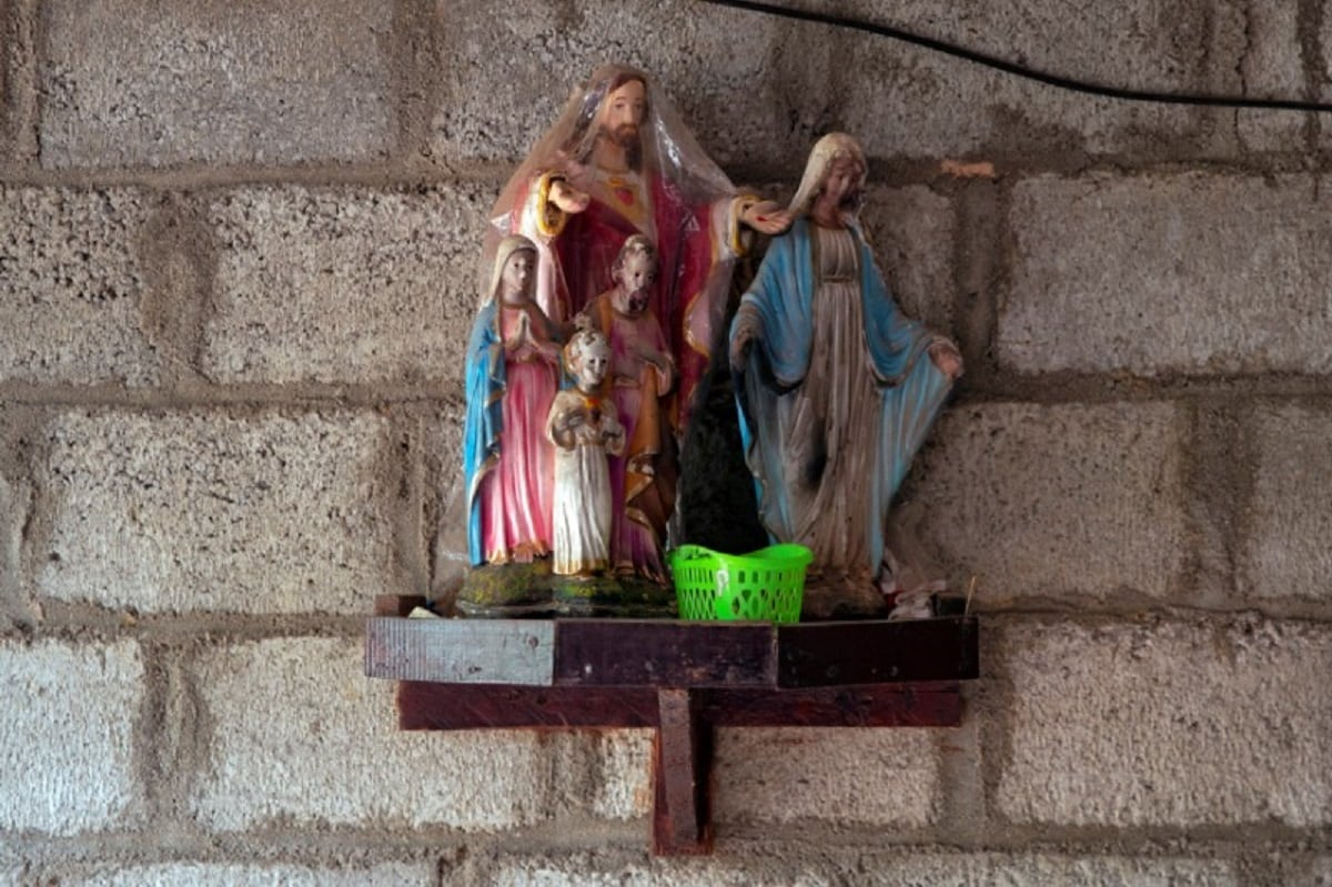 Statues of Mary and Jesus are seen inside the unfinished house of Lahiru Prasanga Fernando, 34, and his wife Diliini Sangeewani, 34, in Negombo. REUTERS/Danish Siddiqui