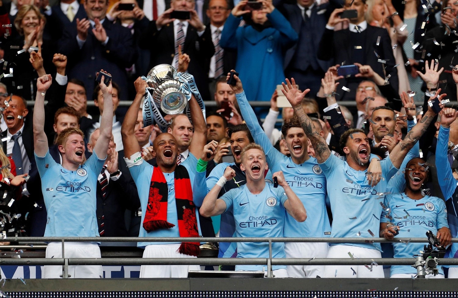 Soccer Football - FA Cup Final - Manchester City v Watford - Wembley Stadium, London, Britain - May 18, 2019 Manchester City's Vincent Kompany lifts the trophy as they celebrate after winning the FA Cup Action Images via Reuters/John Sibley