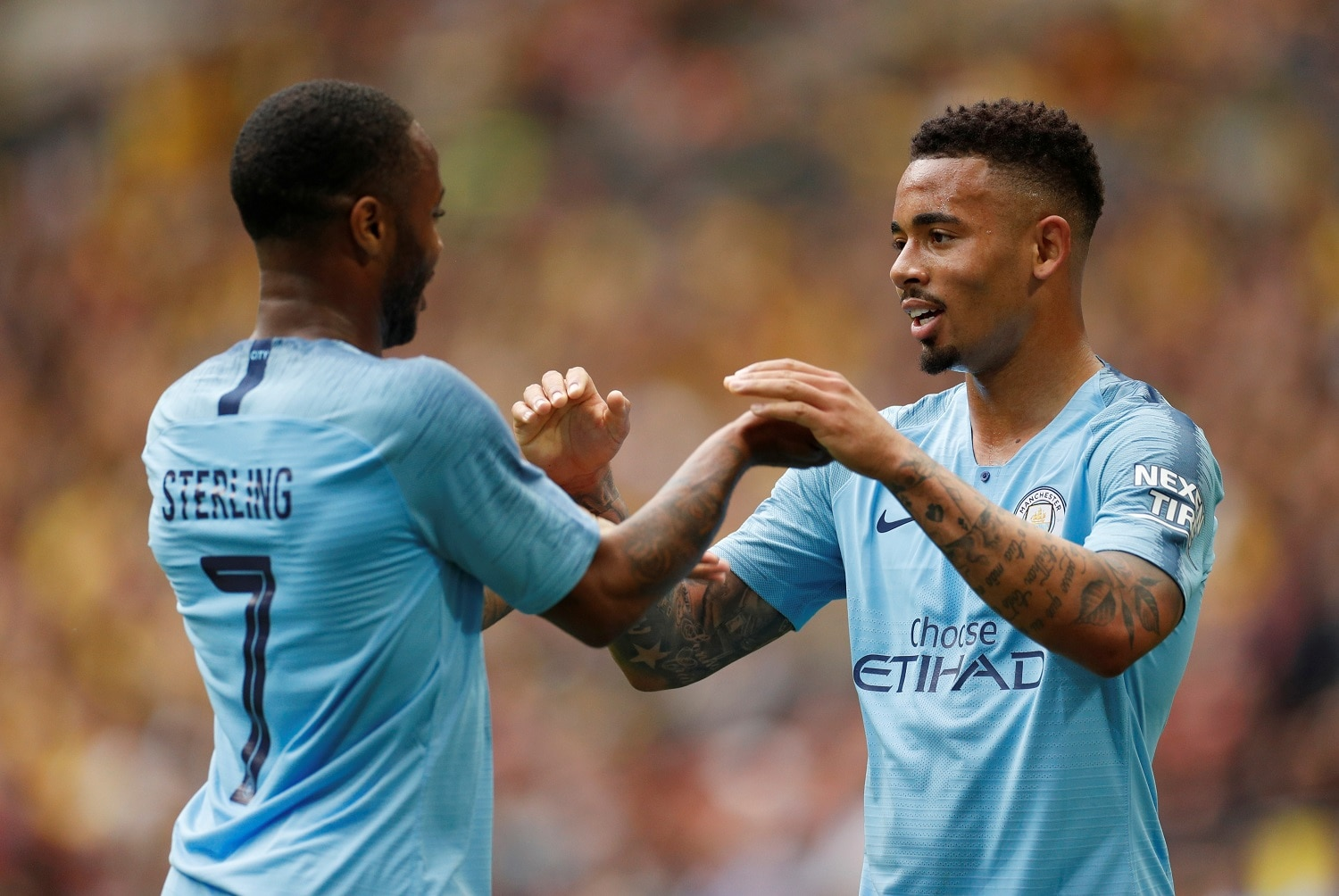 Soccer Football - FA Cup Final - Manchester City v Watford - Wembley Stadium, London, Britain - May 18, 2019 Manchester City's Gabriel Jesus celebrates scoring their fourth goal with Raheem Sterling Action Images via Reuters/John Sibley