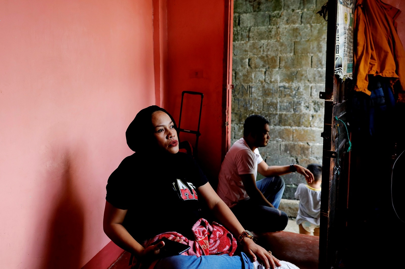 Noronisah Laba Gundarangin, 40, sits inside her sister's home in Marawi City, Lanao del Sur province, Philippines, May 13, 2019. REUTERS/Eloisa Lopez