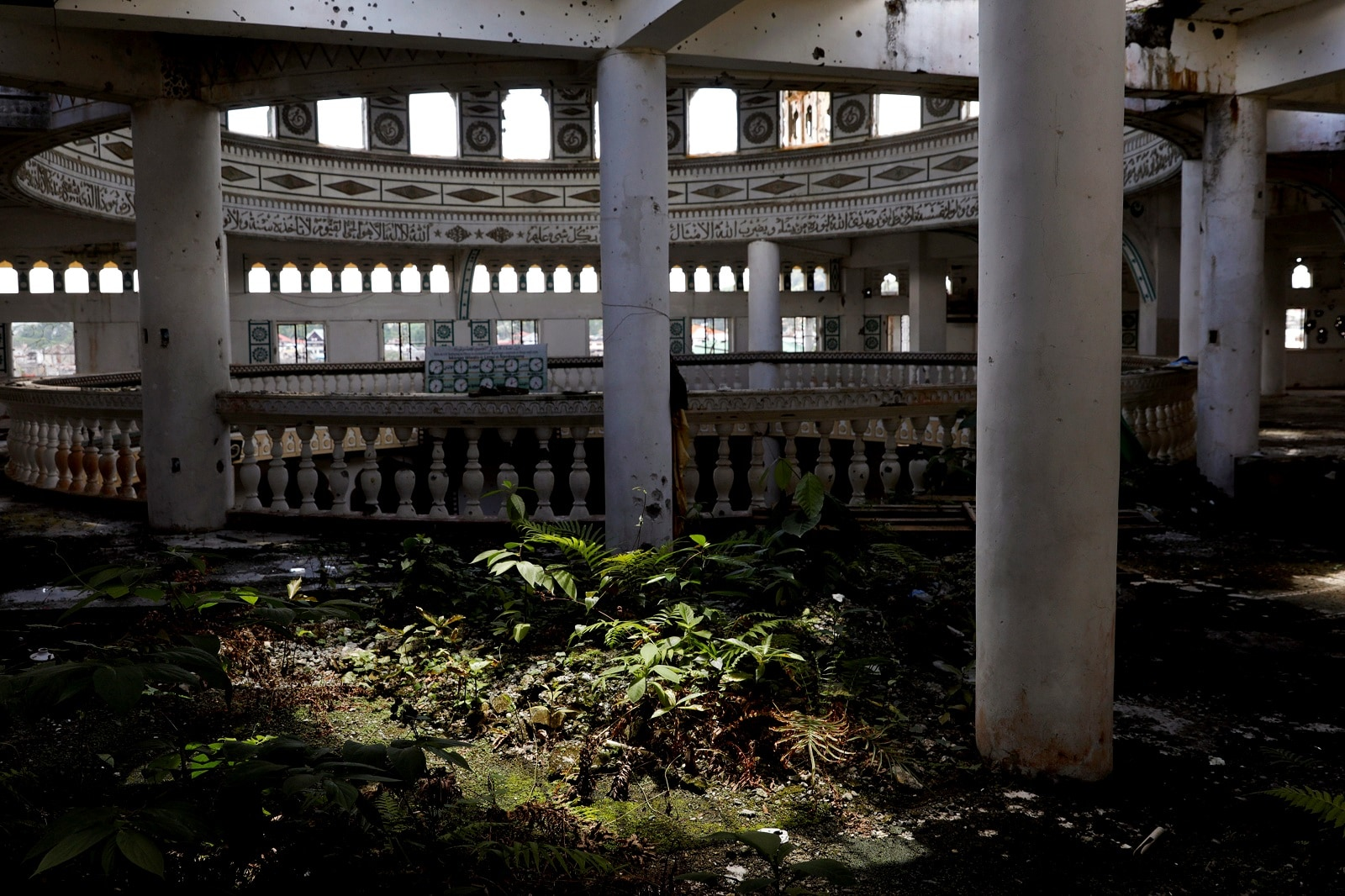 Weeds have grown at the bullet-riddled Grand Mosque in Marawi City, Lanao del Sur province, Philippines, May 11, 2019. REUTERS/Eloisa Lopez