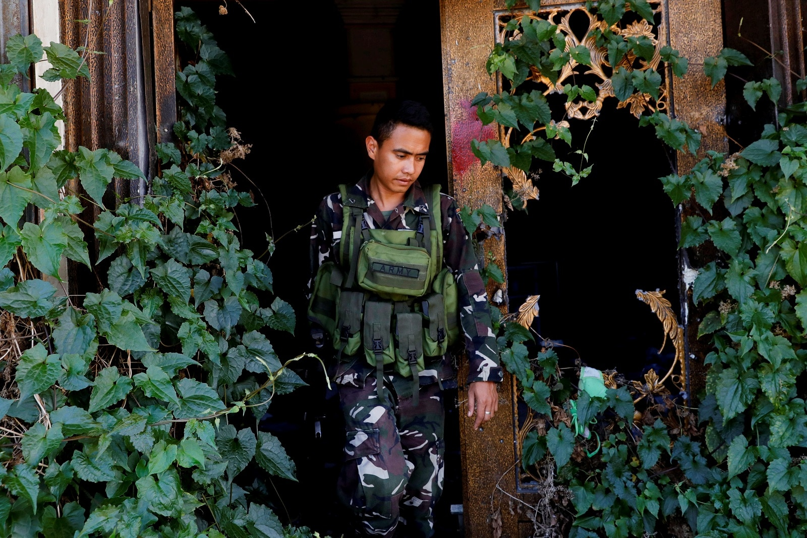 A soldier walks out of a destroyed structure at the most affected war-torn area of Marawi City, Lanao del Sur province, Philippines, May 11, 2019. REUTERS/Eloisa Lopez