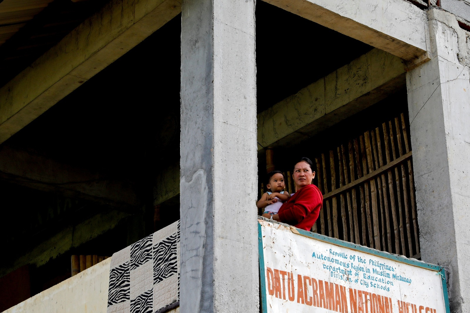 Marie Dalama Acampong, 37, carries her one-year-old daughter Norlaila at the school-turned-evacuation center in Mipaga, Marawi City, Lanao del Sur province, Philippines, May 12, 2019. REUTERS/Eloisa Lopez