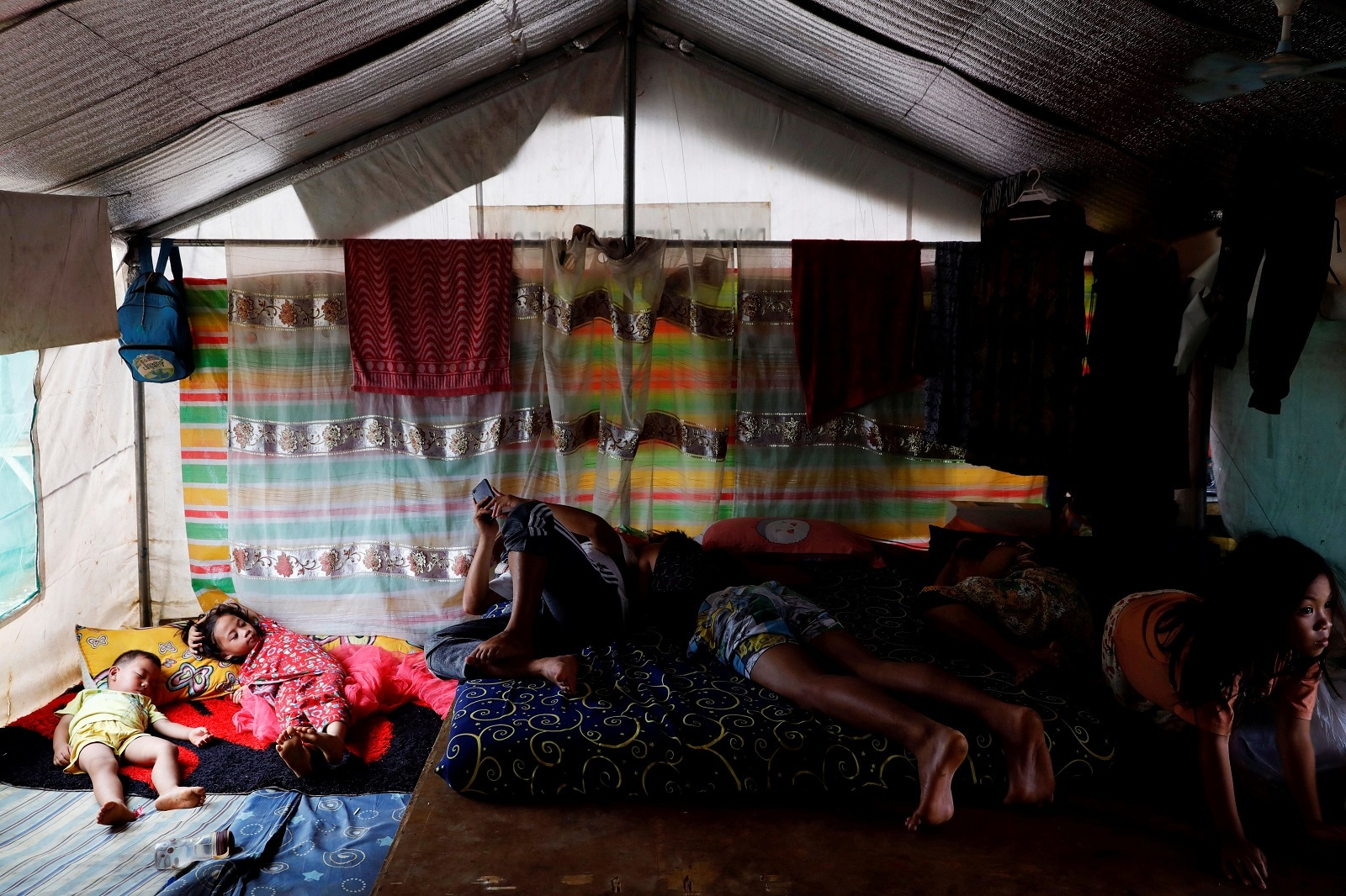 A family takes a nap in a tent at an evacuation camp for families displaced by the Marawi siege, in Marawi City, Lanao del Sur province, Philippines, May 12, 2019. REUTERS/Eloisa Lopez