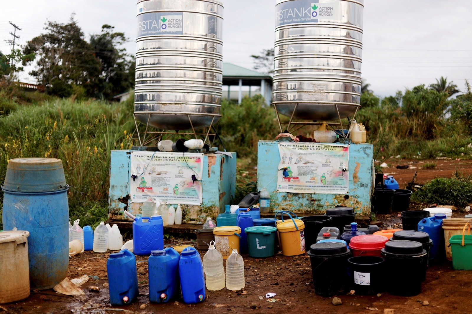 Containers are lined up beside a water tank at an evacuation camp in Marawi City, Lanao del Sur province, Philippines, May 12, 2019. REUTERS/Eloisa Lopez