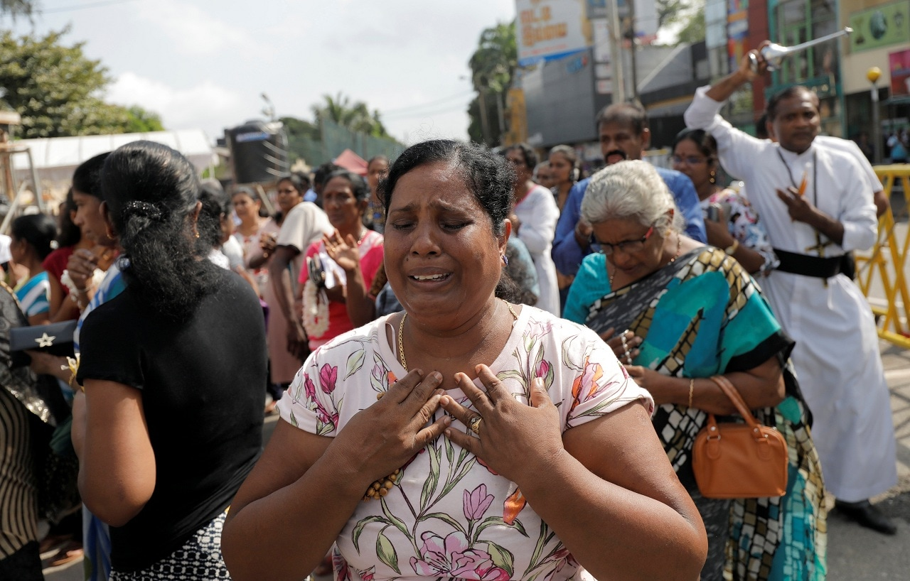 A devotee cries while praying in front of St Anthony's church, one of the churches attacked in the April 21st Easter Sunday Islamic militant bombings, during the first-month remembrance service, in Colombo, Sri Lanka May 21, 2019. (Reuters)