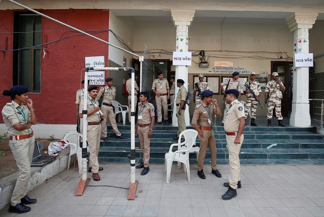 Police stand guard outside a vote counting centre in Ahmedabad, India, May 23, 2019. REUTERS/Amit Dave