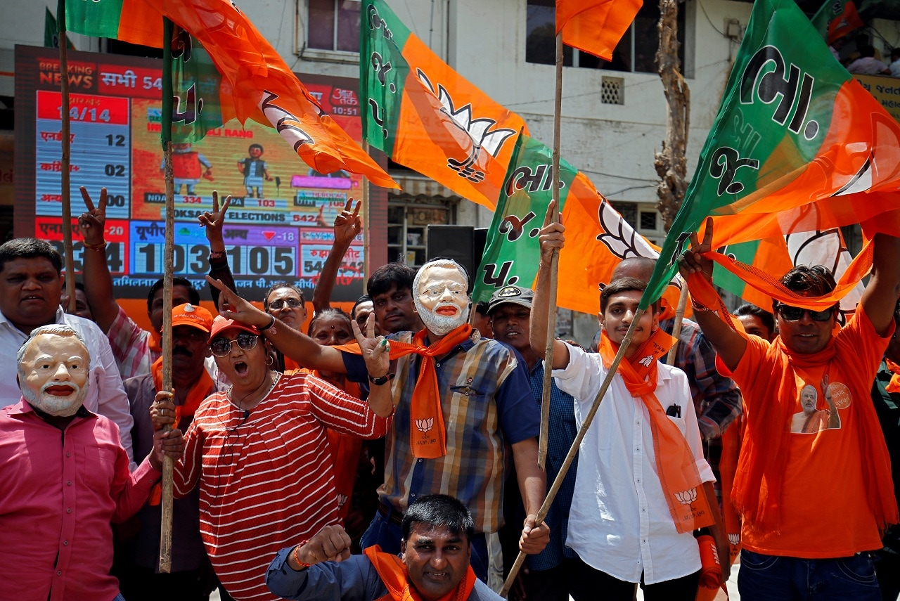 Supporters of Bharatiya Janata Party (BJP) celebrate after learning of initial poll results in Ahmedabad, India, May 23, 2019. REUTERS/Amit Dave