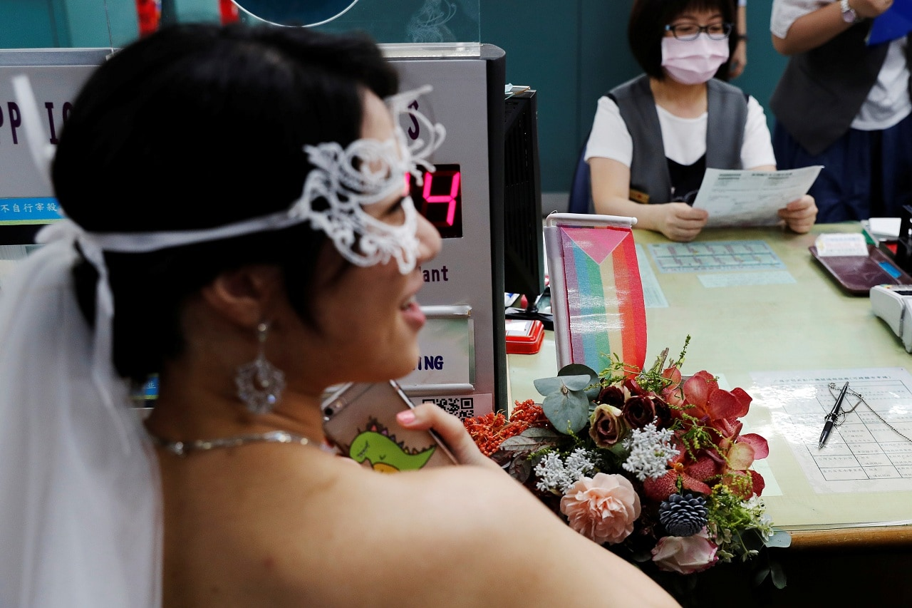 A rainbow flag is seen on a desk at the Household Registration Office as same-sex couples register for marriage, in Shinyi District in Taipei, Taiwan May 24, 2019. REUTERS/Tyrone Siu
