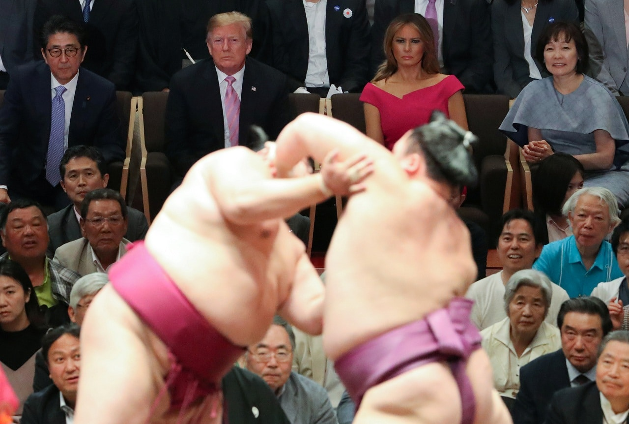 Japanese Prime Minister Shinzo Abe and US President Donald Trump, with their wives Melania Trump and Akie Abe, watch sumo wrestlers compete in the Summer Grand Sumo Tournament at Ryogoku Kokigikan Sumo Hall in Tokyo, Japan May 26, 2019. REUTERS/Jonathan Ernst