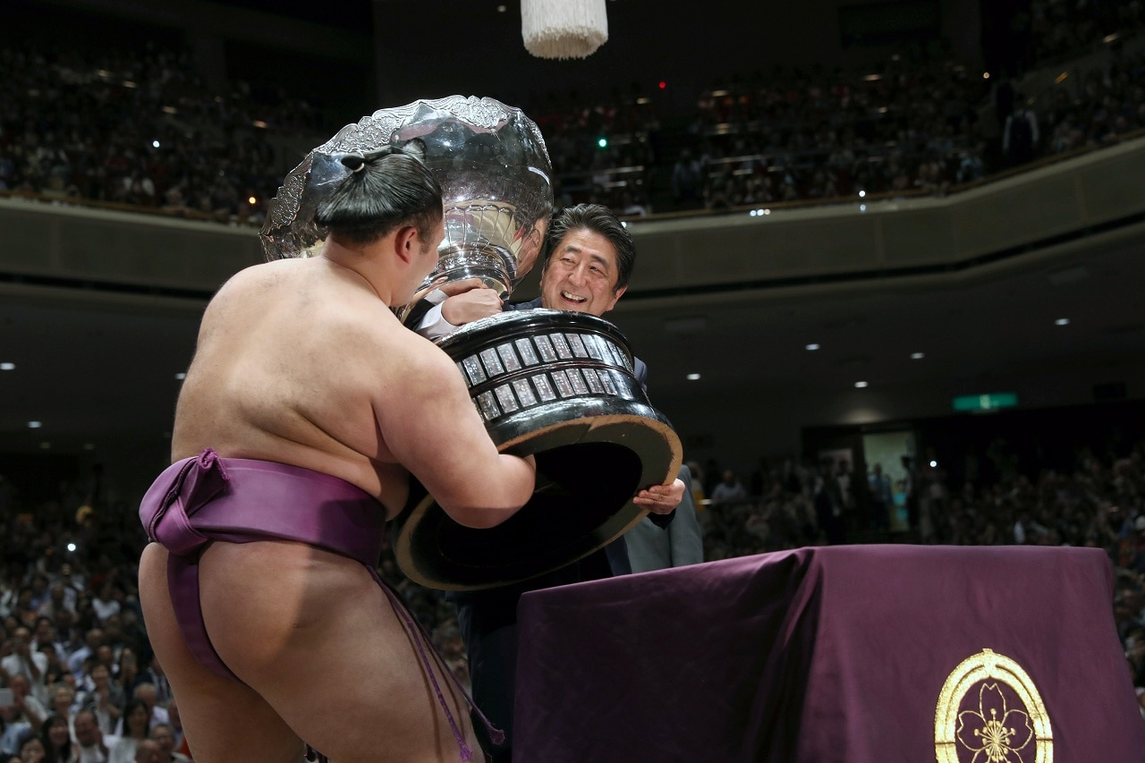 Japanese Prime Minister Shinzo Abe presents the Prime Minister's Cup to wrestler Asanoyama, the winner of the Summer Grand Sumo Tournament at Ryogoku Kokigikan Sumo Hall in Tokyo, Japan May 26, 2019. REUTERS/Jonathan Ernst