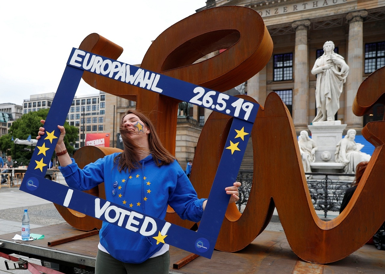 A woman attends an event by pro-European