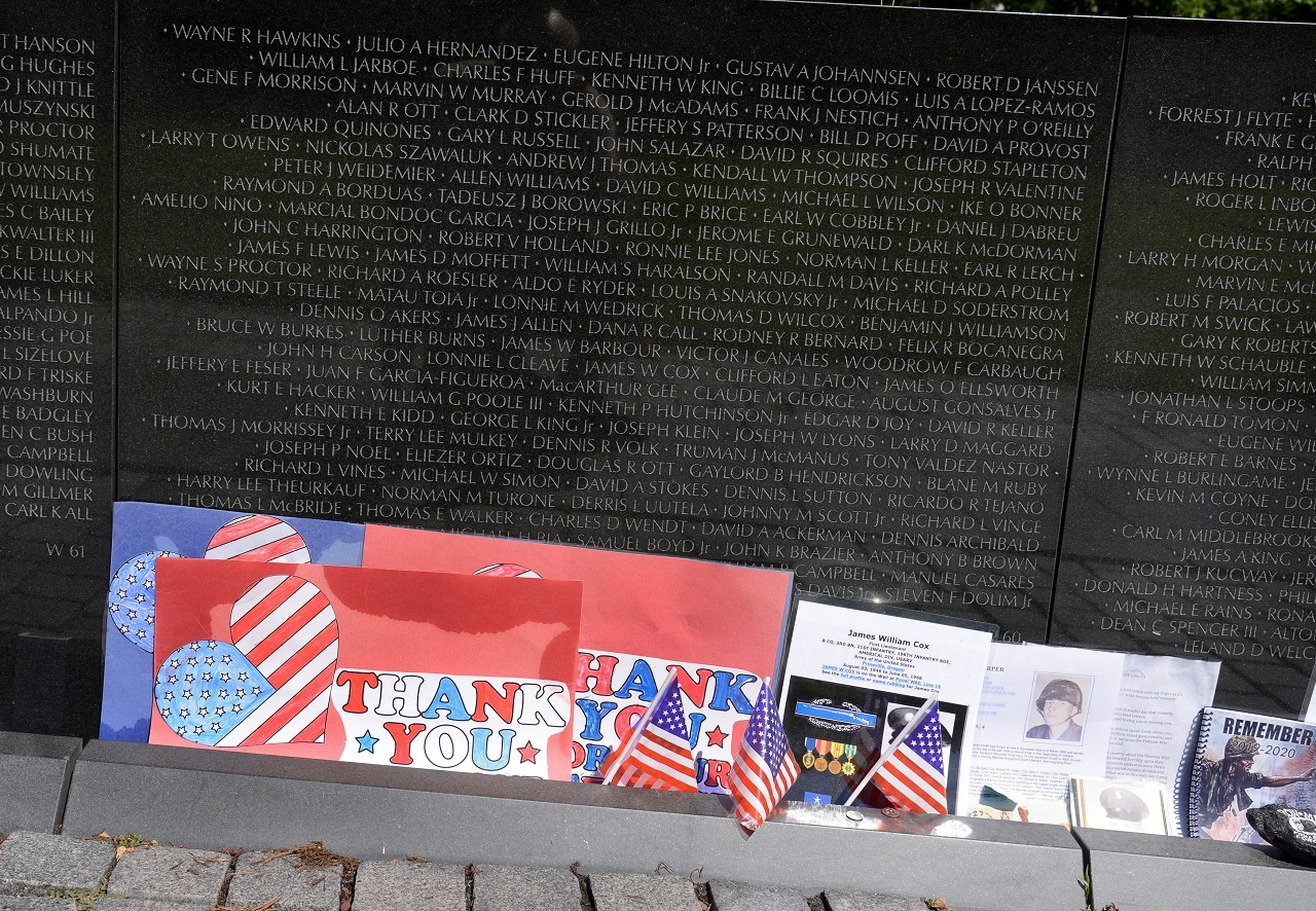 Notes and photos are seen left at the Vietnam Veterans Memorial wall prior to the start of the 32nd Annual, and possibly final, Rolling Thunder