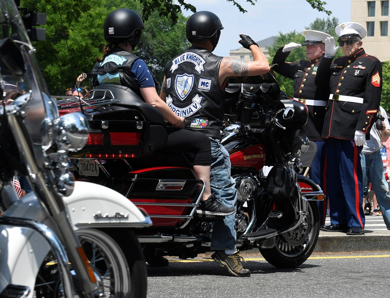 A motorcycle rider stops to salute USMC Staff Sgt. Tim Chambers (ret.), and USMC Sgt. Bruce Heilman (ret.), 93, of Richmiond, Virginia, during the 32nd Annual, and possibly final, Rolling Thunder