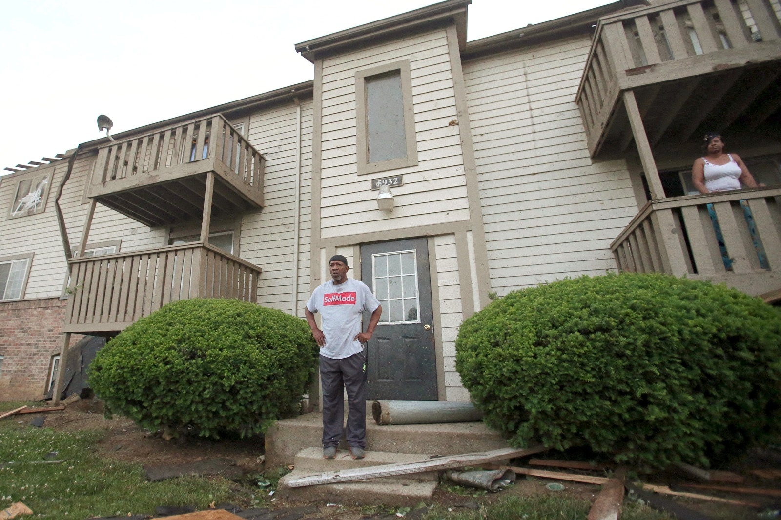A man stands in front of his apartment after a tornado touched down overnight in Trotwood near Dayton, Ohio, US May 28, 2019. REUTERS/Aaron Josefczyk