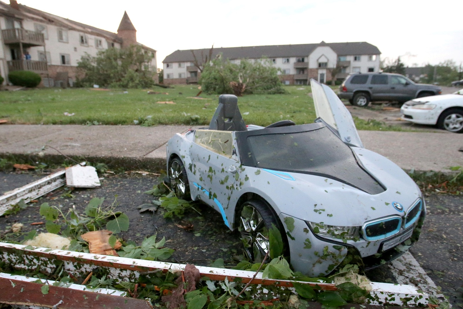 A child's toy car sits among debris from a tornado that touched down overnight in Trotwood near Dayton, Ohio, US May 28, 2019. REUTERS/Aaron Josefczyk