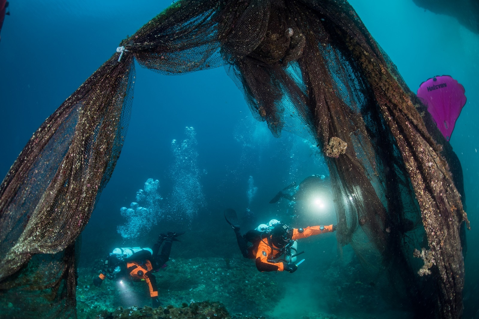 Divers swim between a ghost fishing net on the seabed in the village of Stratoni near Halkidiki, Greece, May 18, 2019. Cor Kuyvenhoven/Ghost Fishing Greece/Handout via REUTERS