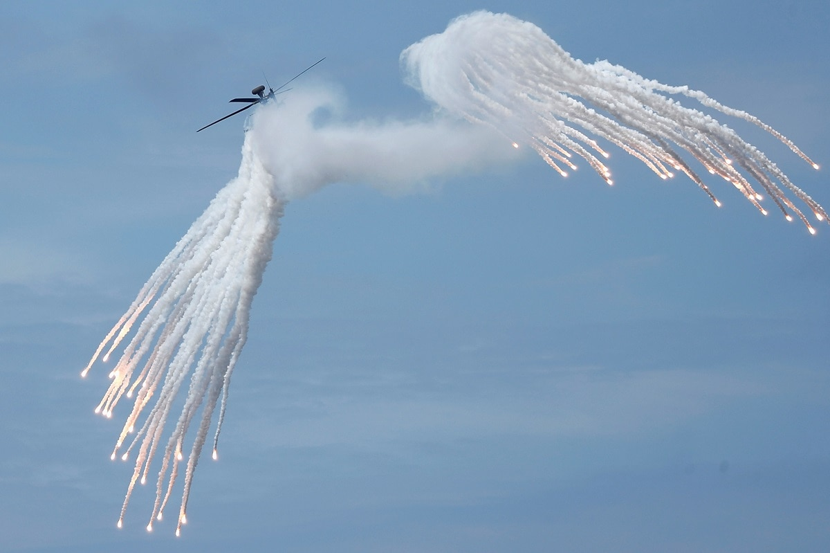 An AH-1W attack helicopter releases flares during the live fire Han Kuang military exercise, which simulates China's People's Liberation Army (PLA) invading the island, in Pingtung, Taiwan. REUTERS/Tyrone Siu
