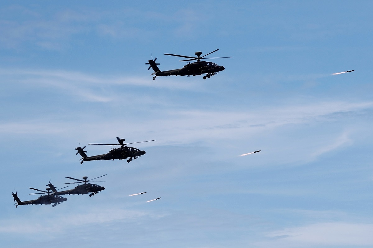 AH-1W attack helicopters launch Hellfire missiles. REUTERS/Tyrone Siu