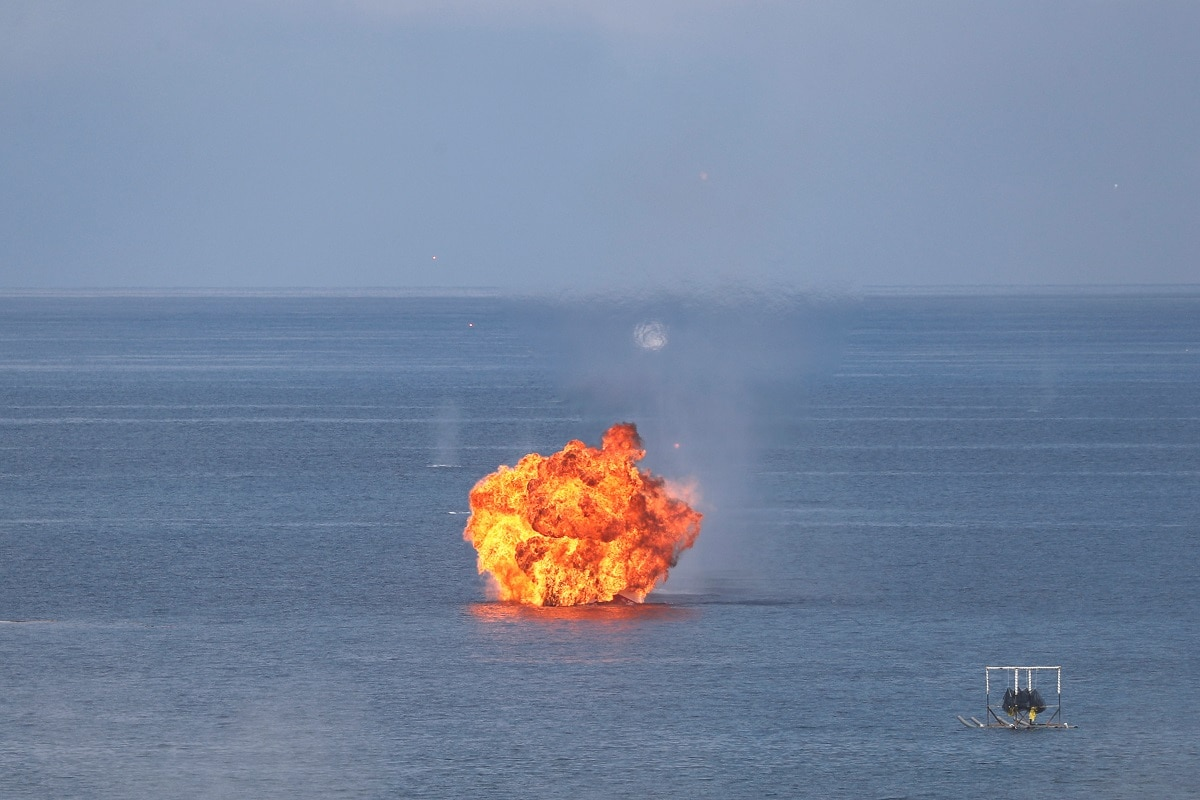 Explosions are seen at a target during the live fire Han Kuang military exercise. REUTERS/Tyrone Siu