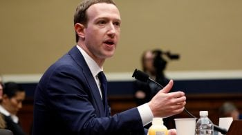 Facebook CEO Mark Zuckerberg, under fire, seeks to mend fences in Washington