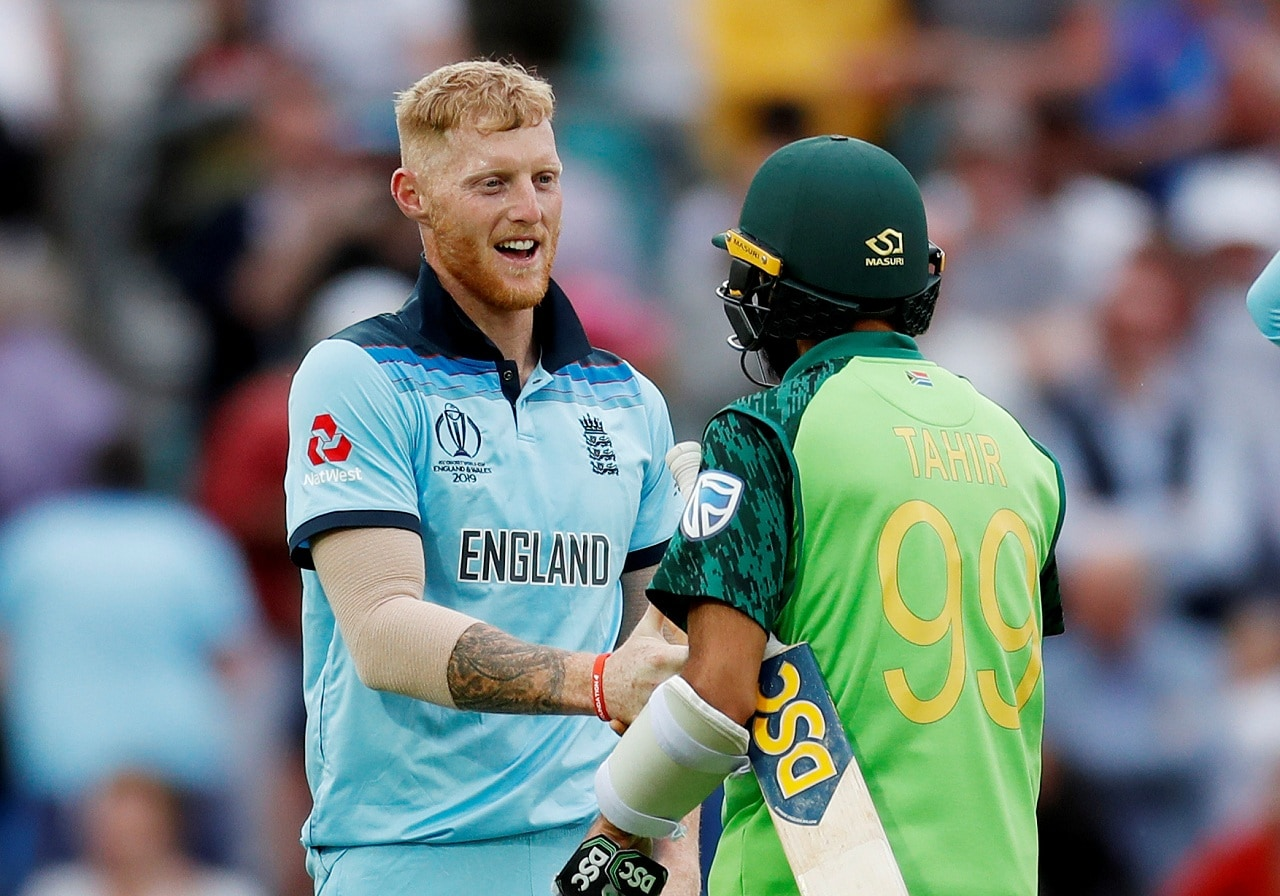 Cricket - ICC Cricket World Cup - England v South Africa - Kia Oval, London, Britain - May 30, 2019 England's Ben Stokes with South Africa's Imran Tahir after winning the match Action Images via Reuters/Paul Childs