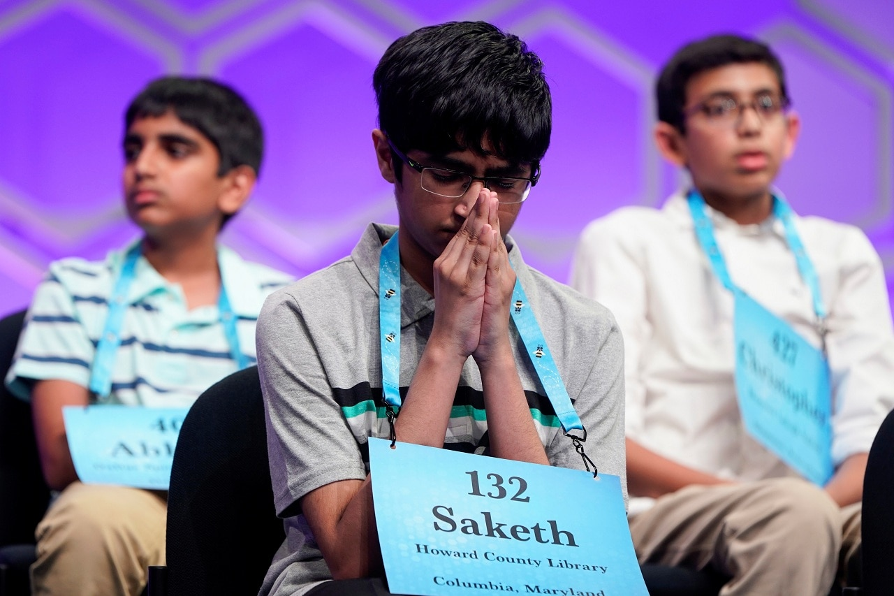 Saketh Sundar, 13, Clarksville, Maryland, one of eight co-champions, puts his hands together during the final round of the 92nd annual Scripps National Spelling Bee at National Harbor in Oxon Hill, Maryland, US, May 30, 2019. REUTERS/Joshua Roberts