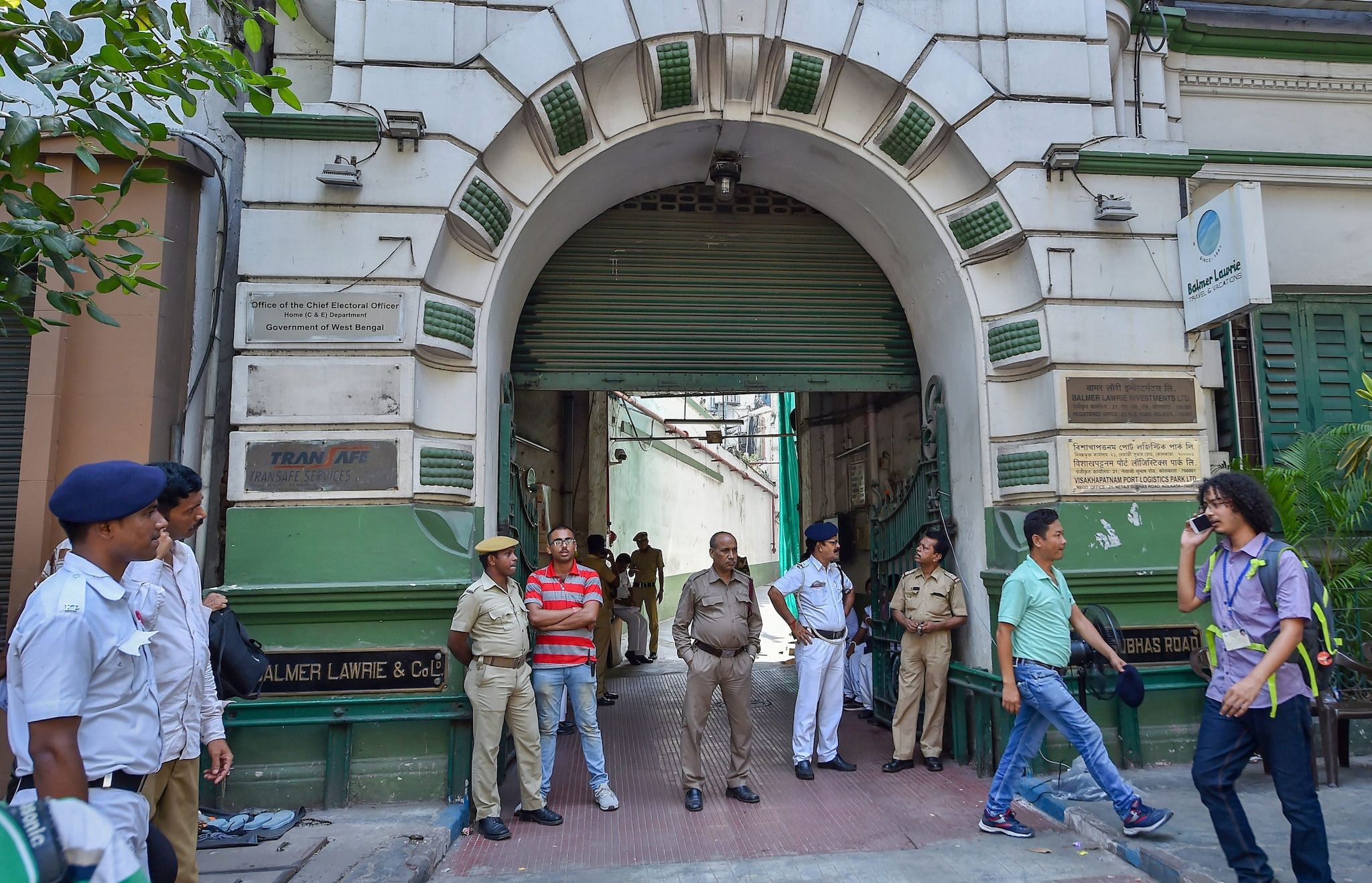Police personnel stand guard in front of Election Commission Office in Kolkata, Saturday, May 11, 2019. (PTI Photo/Ashok Bhaumik)